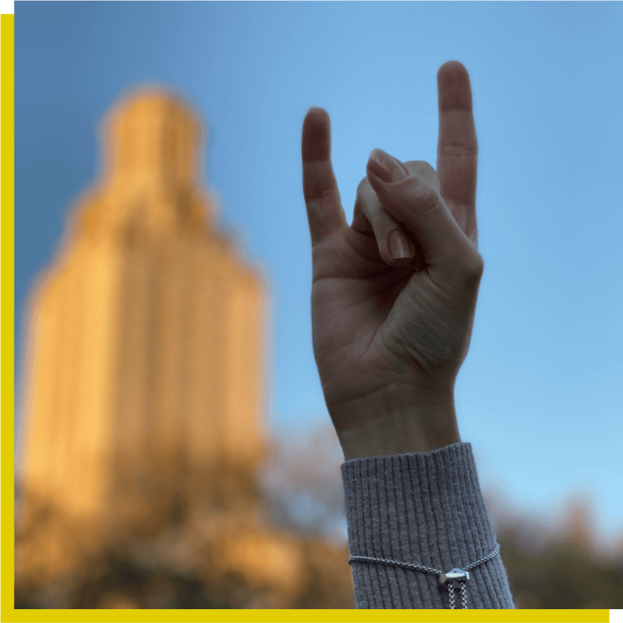 Image of Hook 'em horns in the air